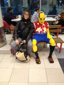 trying to aim up at 3 in the morning sitting next to the lego man in Moscow airport